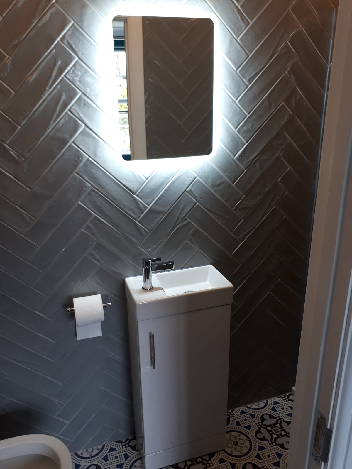 Grey herringbone tile pattern