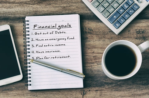 financial-goal-typed-on-note-pad-6567601