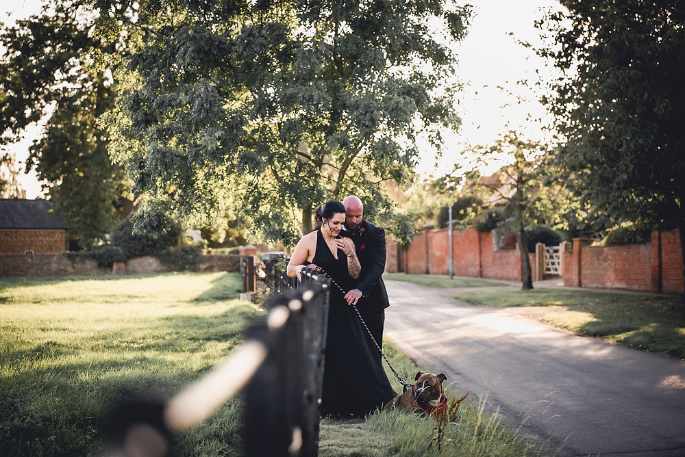 Bride and Groom Walking the Dog