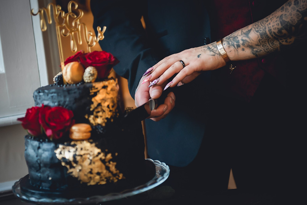 Hands Cutting the Wedding Cake