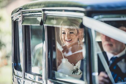 Wedding Photo of Bride in Vintage Car