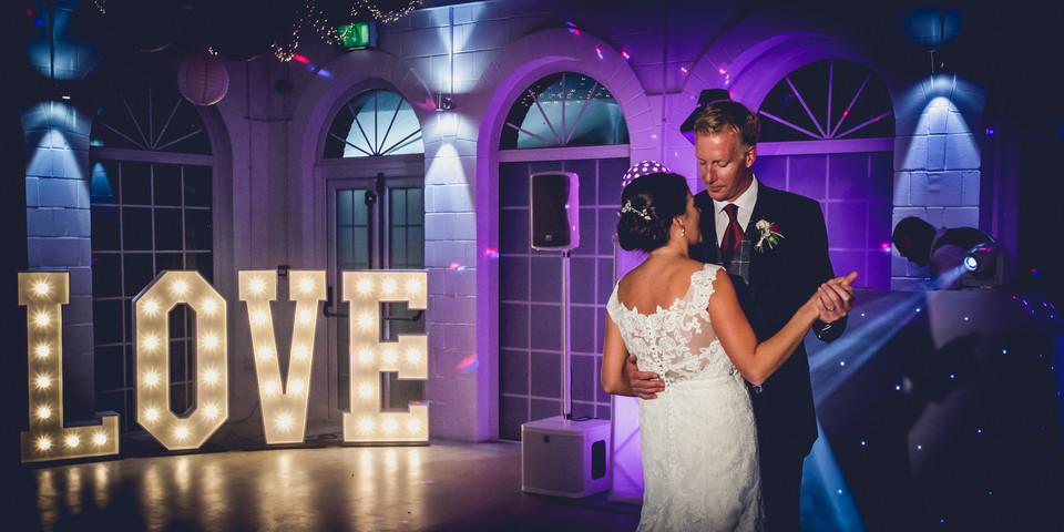 First Dance infront of Love Sign at Irnham Hall