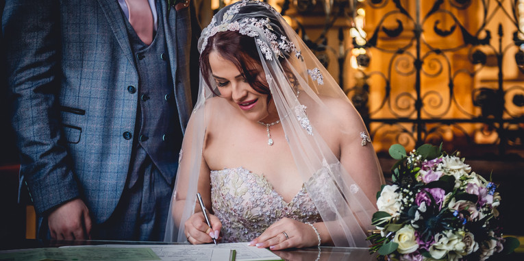 Signing the register at wedding, Ashby-de-la-Zouch