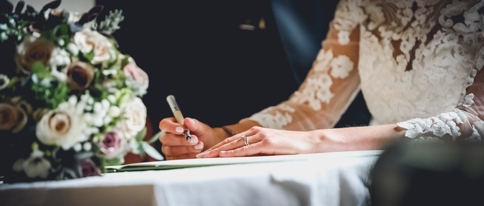 Signing the register close up photo, Foston, Lincolnshire