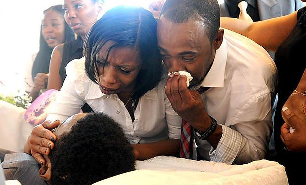 Black Family Crying at Funeral.jpg