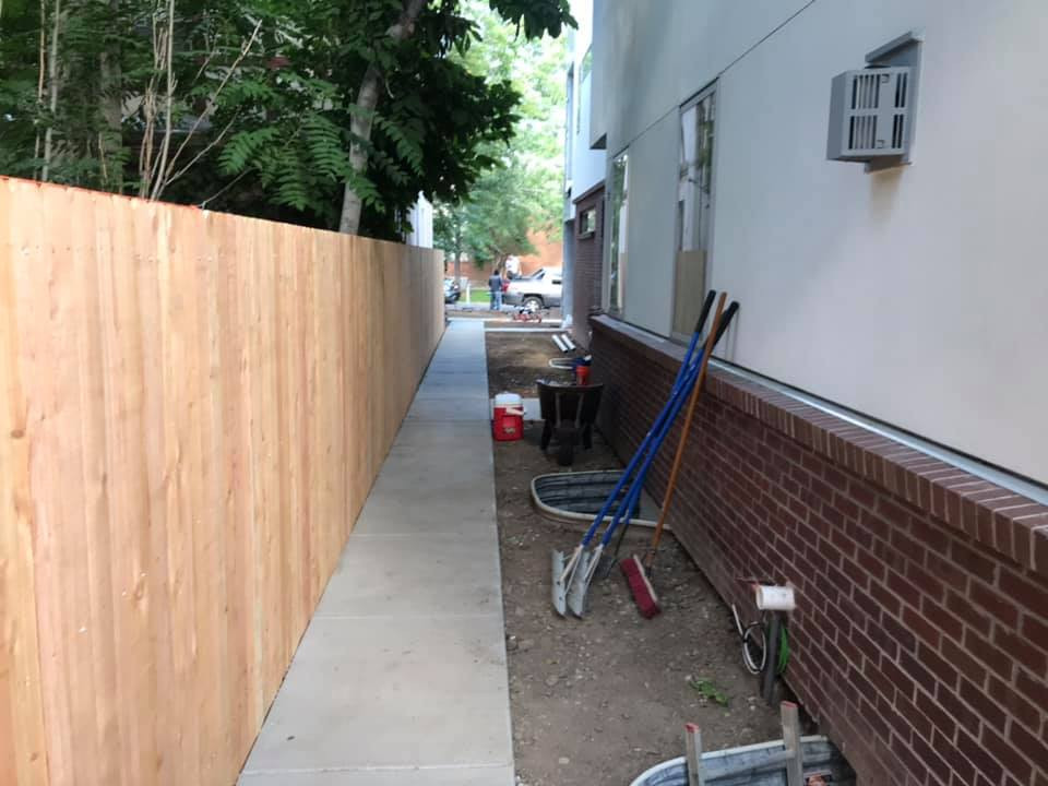GKC Fencing and red brick wall.jpg