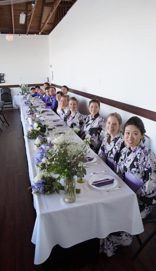 Bridal Party at the Head Table in the Hangar