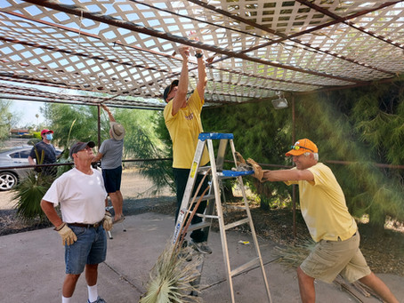 Brotherhood Building the Sukkah -- With Help From Our Guardian of the Biblical Garden!