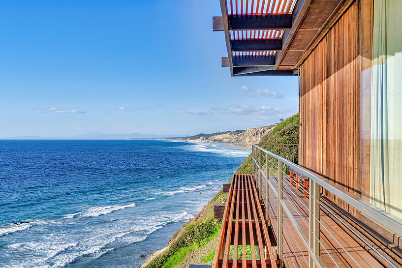 Mountain home overlooking scenic ocean view and blue sky in San Diego California.jpg