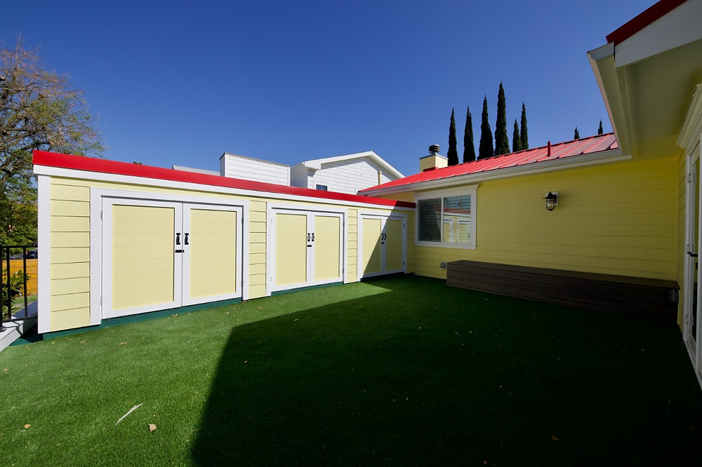 three yellow and red custom storage units attached to a home in sherman oaks, ca