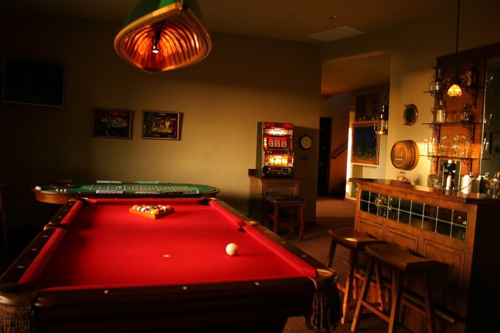 man cave with pool table and bar