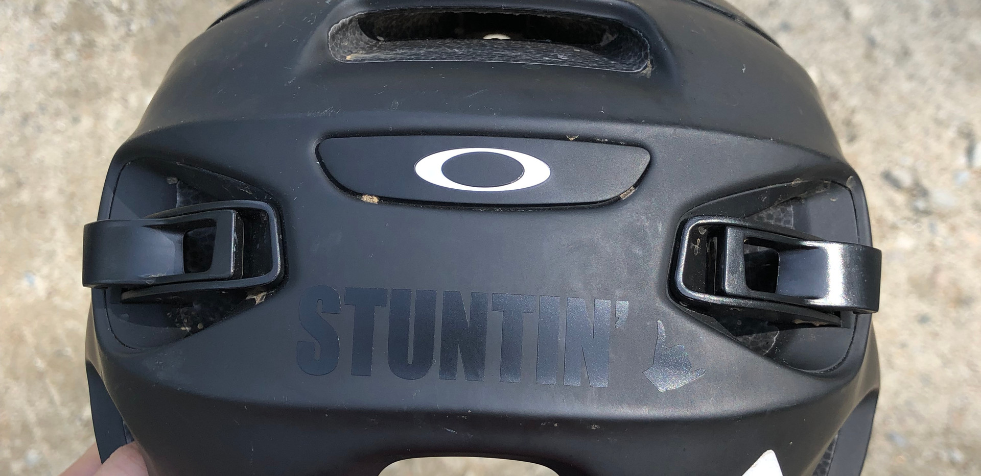 "Black vinyl ""Stuntin"" sticker sitting pretty on a MTB helmet"