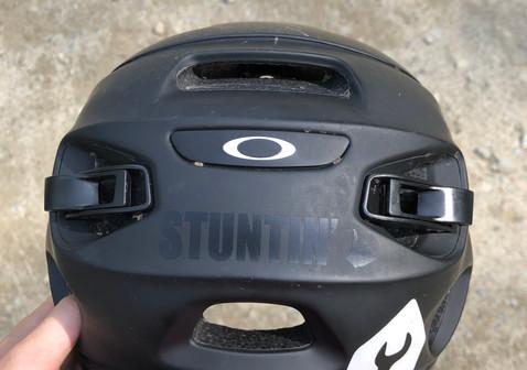 "Black vinyl ""Stuntin"" sticker sitting pretty on a MTB helmet"