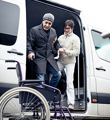 Nurse Helping Senior Man Exit A Van.jpg