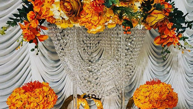 Crystal chandelier flower stand for hire, orange centrepiece, clear centrepiece