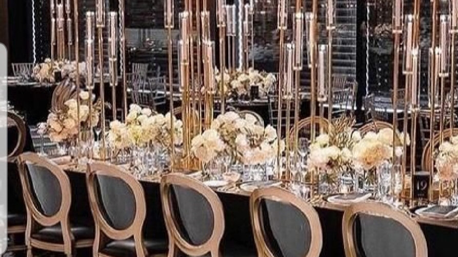 Tall centrepiece, candlestick,9 arm candelabra,gold glass candle holder for hire