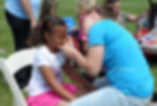 volunteer face painting at maybury farm in northville, mi