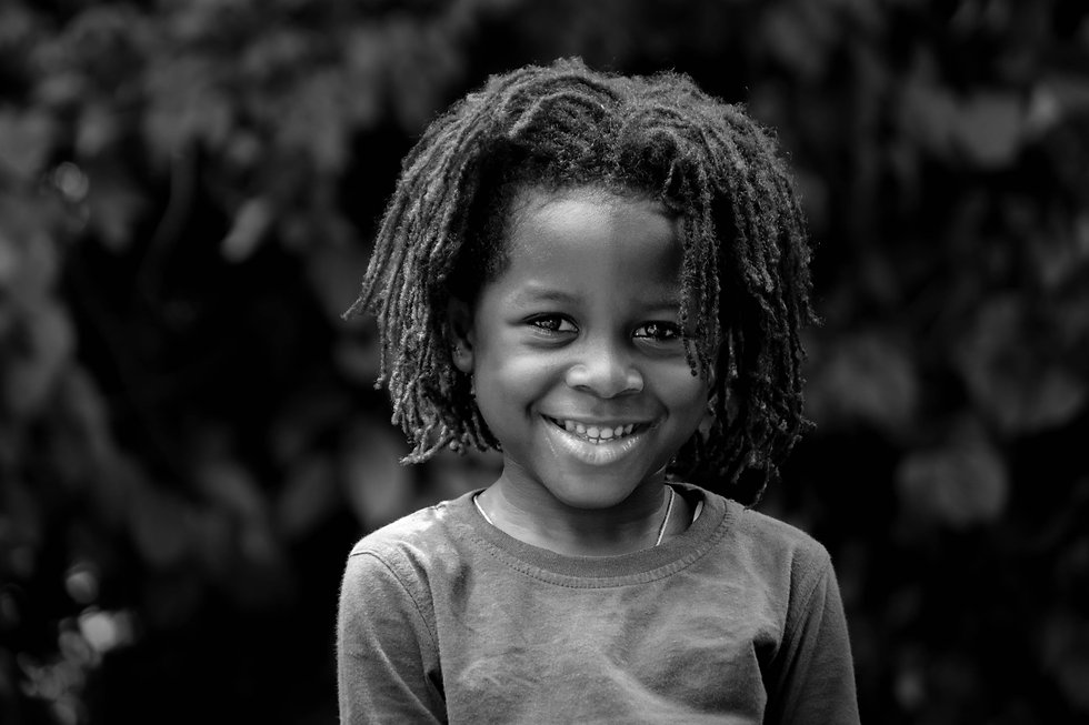 grayscale-photo-of-toddler-with-braided-