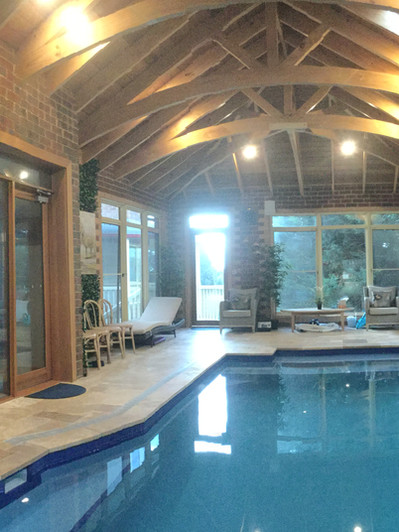 INDOOR POOL ROOM WITH ARCHED EXPOSED ROO