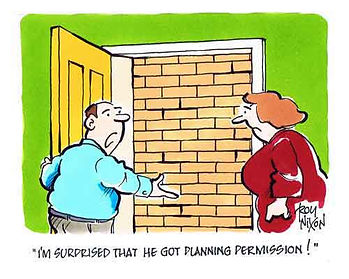 Cartoon showing man with door open onto brick wall questioning if planning permission was needed