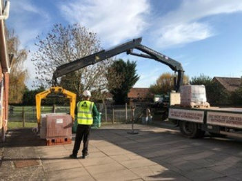 Work starts on village hall by off loading building materials