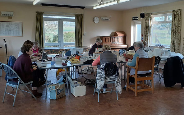 Before Covid, the sewing group hard at work
