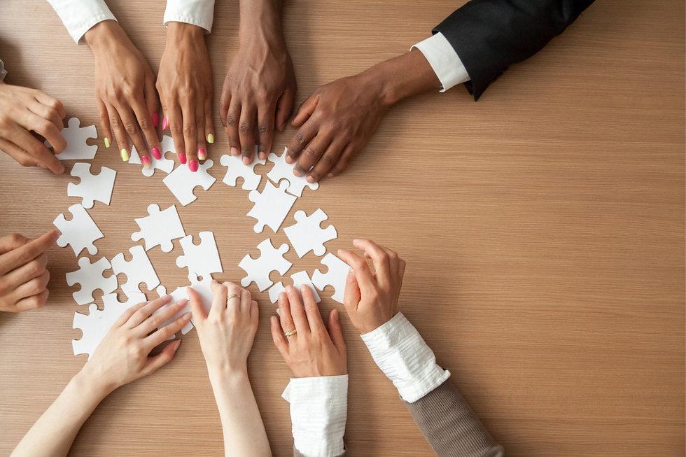 hands-of-multiethnic-business-team-assem