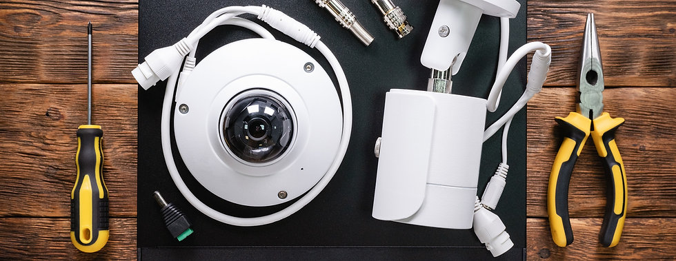 Modern%20white%20security%20cameras%20and%20video%20recorder%20on%20the%20table.%20Video%20surveillance%20concept%20background.%20CCTV%20Installation%20concept.%20Service%20for._edited.jpg