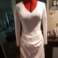 Wedding dress with drape front skirt and