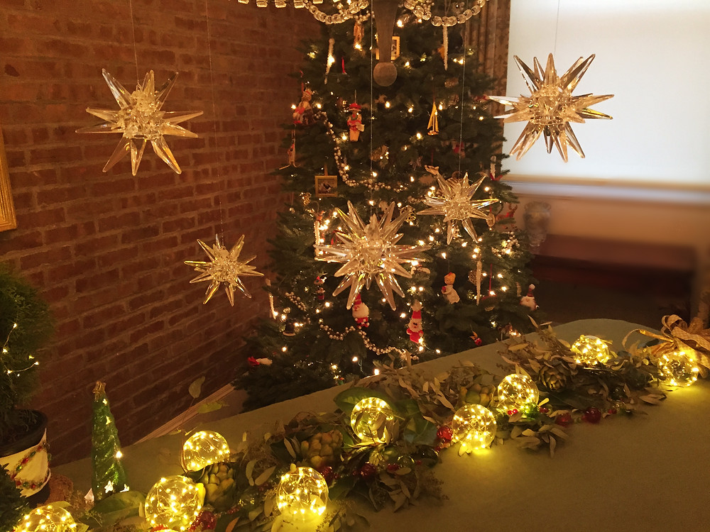 Hang star ornaments from your chandelier