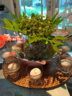 Tablescape Costal theme shells and lovage herb