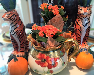 Fall tablescape mixing and matching patterns in orange