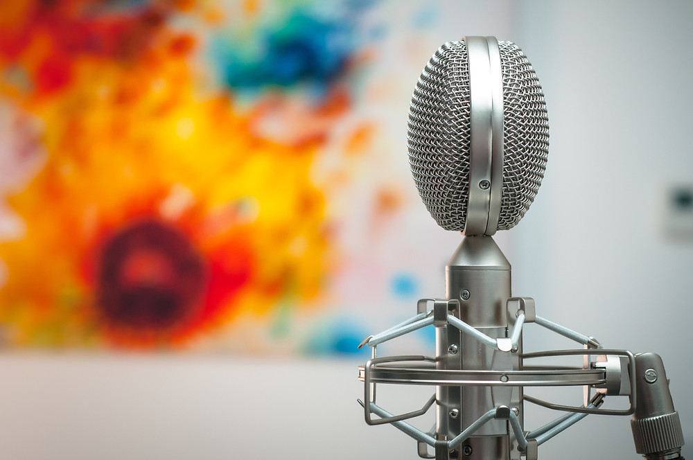 Microphone shown in a room with a painting behind