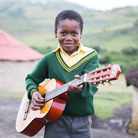 Shooting in rural Kwazulu Natal - a child and his guitar