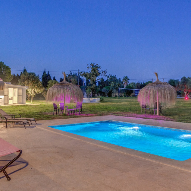 View of the swimming pool by night.