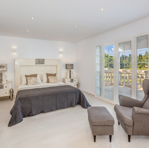 Master bedroom which has own door to the outside terrace and garden including dressing room, Tv, private bathroom and office desk