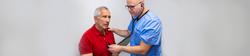 Man-Checking-heart-Website-Urgent-Care-1