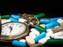 reloj-antiguo-multicolor-drogas-capsulas