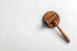 Judge's gavel on light background, top v