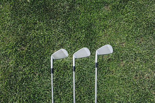 three-golf-clubs-on-green_4460x4460.jpg