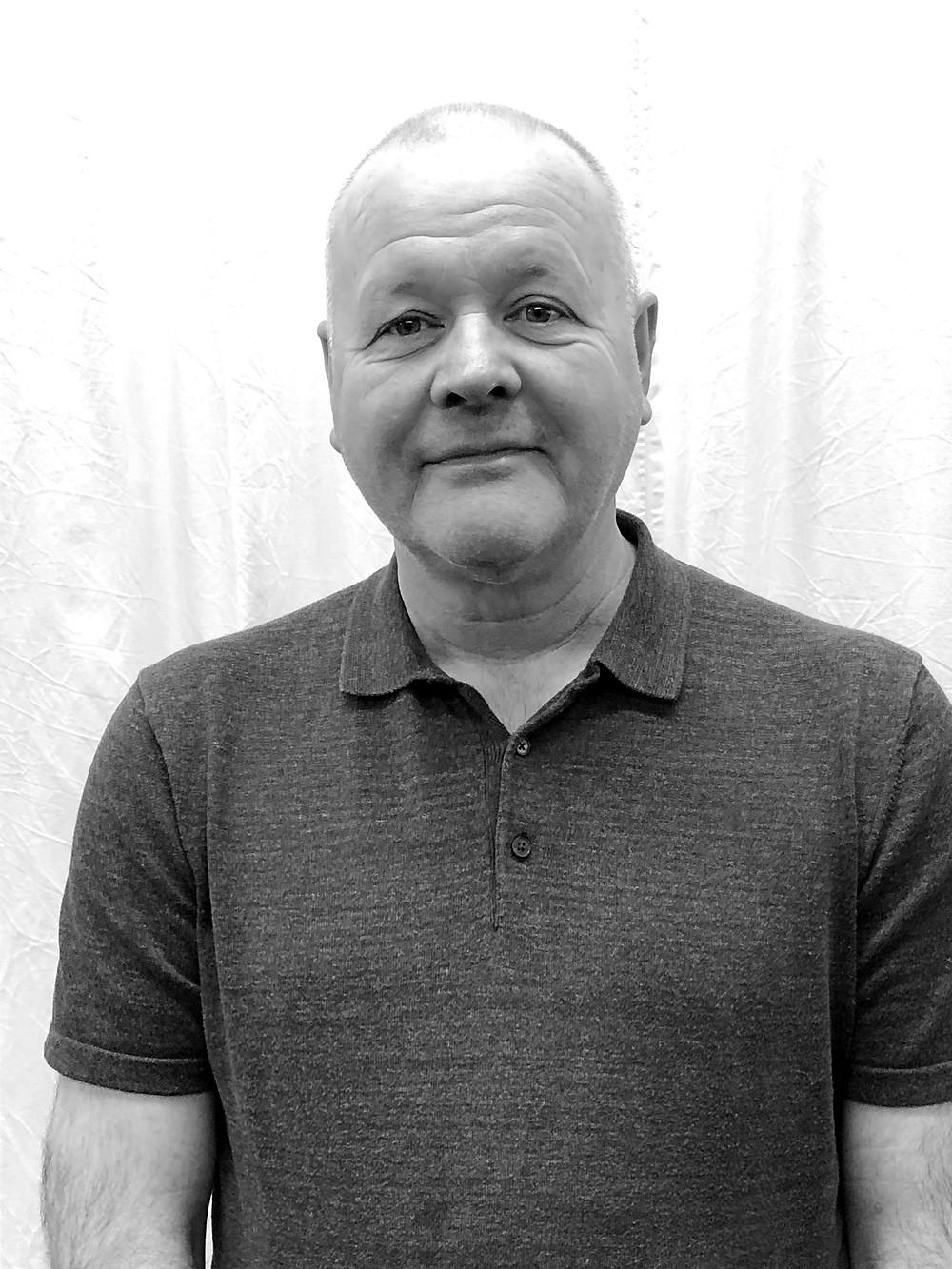 Black and white image of Lee Tassie