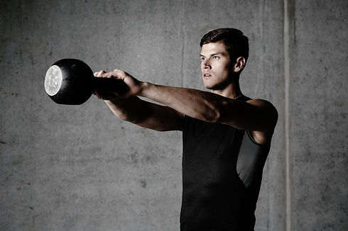 Young-bodybuilder-working-out-with-a-kettlebell.jpg