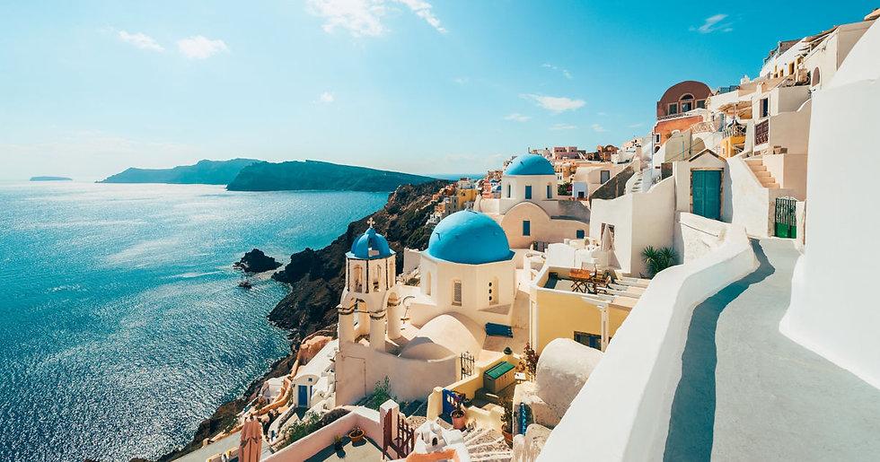 white-buildings-near-blue-water-oia-santorini-greece-cq5dam.web.1200.630.jpeg
