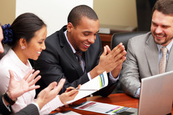photodune-5991085-multi-ethnic-business-team-at-a-meeting-interacting-focus-on-a