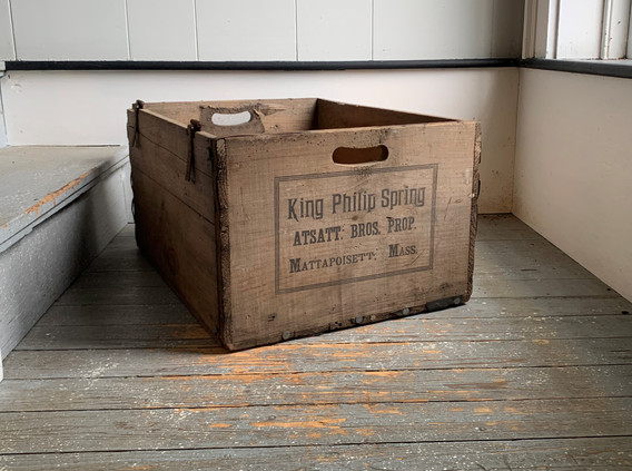 A crate once used to deliver water from the King Philip Spring.