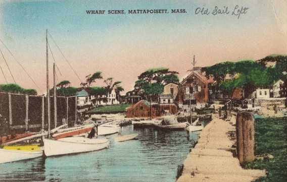Postcard showing the Mattapoisett wharves. Note the sail loft in the back.