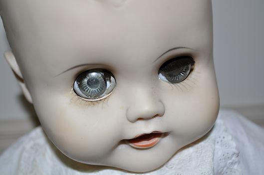 antique baby doll creepy