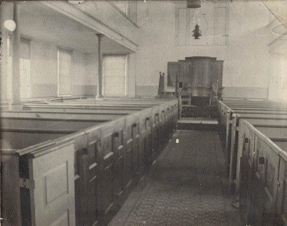 Interior of the Christian Church, before the altar was replaced.
