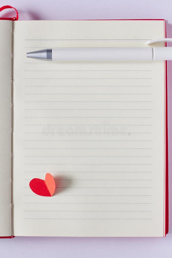 blank-page-notebook-pen-red-paper-heart-