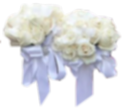 Photo of two white rose bouquets with light blue ribbon and rhinestone embellishment.